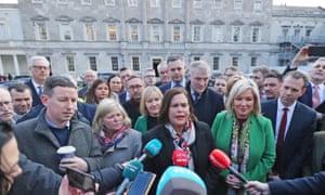 The Sinn Féin leader, Mary Lou McDonald and party members outside Leinster House in Dublin