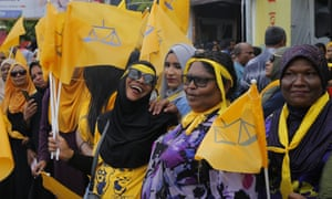 Supporters of Ibrahim Mohamed Solih, the president-elect of the Maldives celebrate their victory