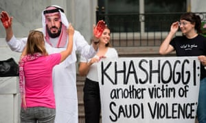A demonstrator with fake blood on his hands dresses as Mohammed bin Salman, the crown prince of Saudi Arabia, outside the Saudi embassy in Washington