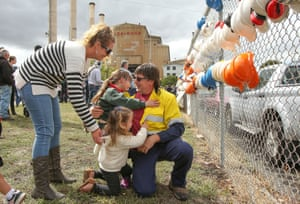 Hazelwood Power Station worker Robb Ortel is embraced by his family after he finished his last shift and hung his hard hat on the fence outside. Around 750 workers were left jobless at the end of the final day of the coal plant's operation.