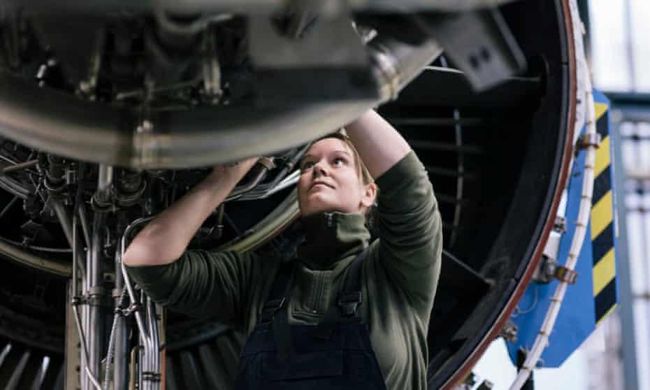 Female engineer working on jet engine