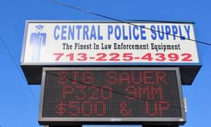 A sign advertising gun sales in Houston, Texas.