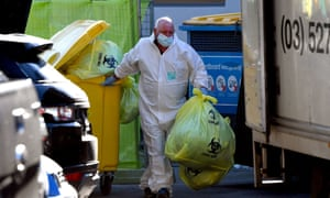 A worker removes medical waste from a Melbourne  aged care facility
