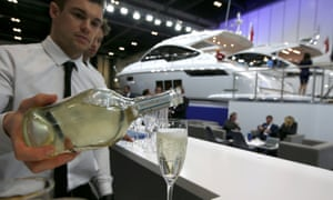 A waiter pours some bubbly at the London Boat Show