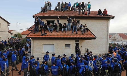 Israeli police try to evacuate supporters of settlements in the occupied West Bank.