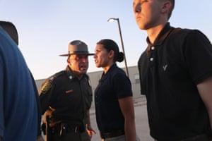 A border patrol instructor yells at a trainee