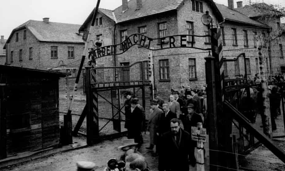 Members of the Frankfurt Auschwitz trial commission enter the former Nazi concentration camp, December 1964