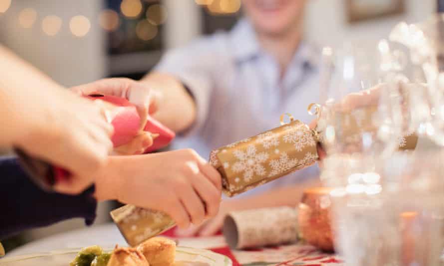 Family pulls crackers over Christmas dinner