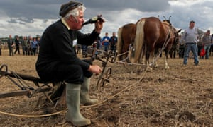A man enjoys a bottle of 'real Guinness' in County Kildare after the European ploughing championships in 2010.