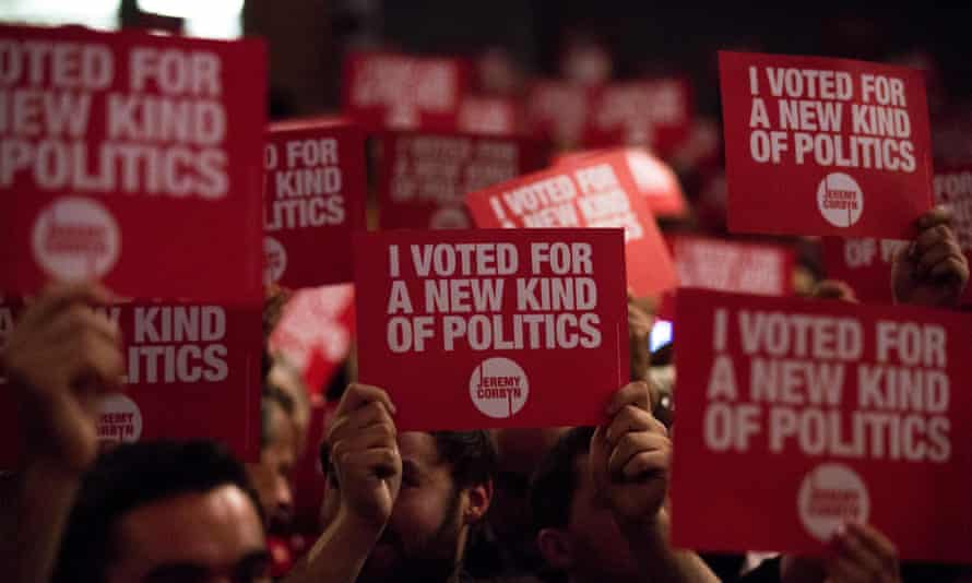 Supporters of Jeremy Corbyn make their point at his final campaign rally.
