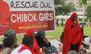 A member of the #BringBackOurGirls Abuja campaign group addresses a protest in Abuja