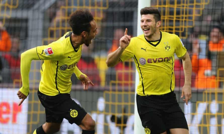 Milos Jojic celebrates with Pierre Emerick-Aubameyang after scoring 17 seconds into his Borussia Dortmund debut.