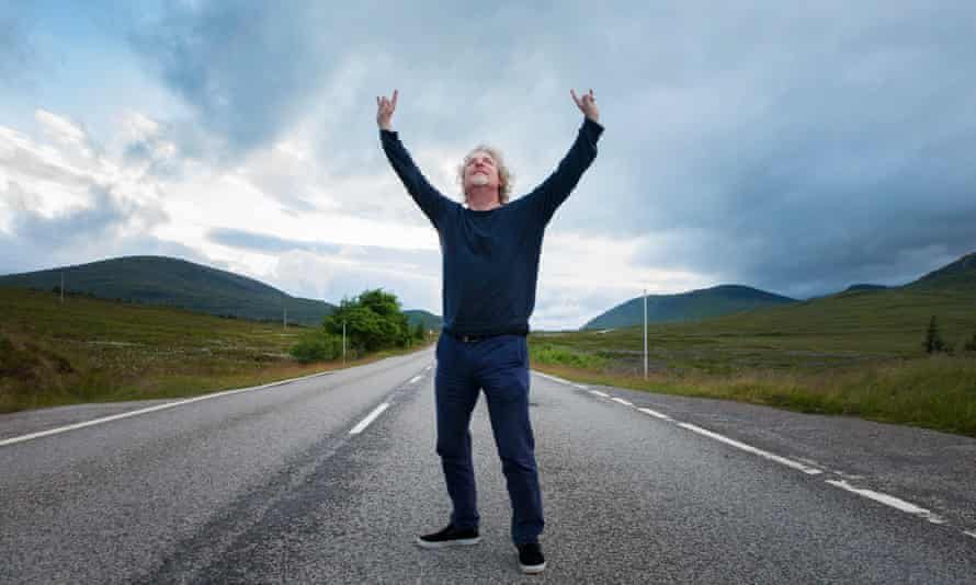 Olaf Furniss in the middle of a road, arms aloft.