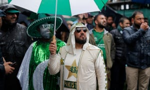 Pakistan fans look for players on the pavilion balcony as rain delays the start of the match between Pakistan and Sri Lanka at the County Ground in Bristol.