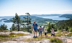 A family hiking Skuleberget, the highest peak in the Skuleskogen national park.