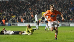 Brett Ormerod celebrates scoring against Tottenham Hotspur at Bloomfield Road.