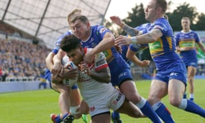 Kevin Naiqama of St Helens runs in a try