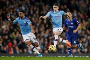 Manchester City's Phil Foden surges forward.