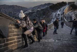 Beijing, ChinaA Chinese tourist uses a friend's scarf as she struggles to climb an icy section of the Great Wall at Badaling.
