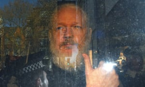 Julian Assange being taken to court last year. One of the requests the information tribunal will examine is from an Italian journalist seeking information about initial attempts to extradite him to Sweden.
