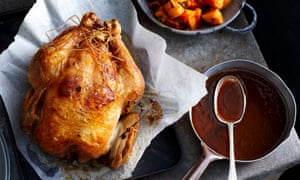 Roast chicken with bowl of gravy<br>Studio 126-8 Herbert StreetSt LeonardsNSW Australia 2065www.brettstevensphotography.com+61 [0] 408 48 40 48