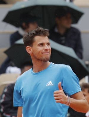 Thiem flashes a thumbs up to spectators