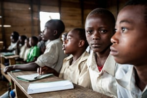 Children who have never been enrolled in school before attend a lesson at Nyange primary school in Mpati
