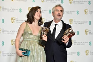 Alfonso Cuaron and his daughter Tessa pose with the awards for Best Film and Best Director for Roma