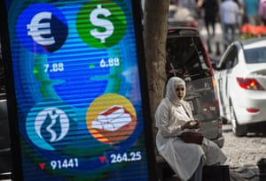 A digital billboard giving updates on various currencies and the Turkish stock exchange in Istanbul today.