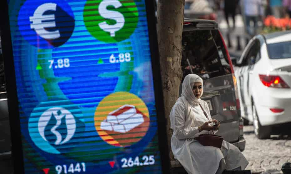 A digital billboard displaying financial information in Istanbul.