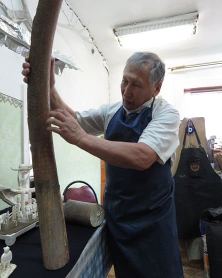 Fedor Markov with a rare mammoth tusk in his studio.