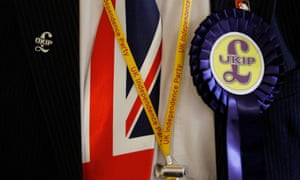 A Ukip delegate wears badges and a Union flag tie at the party's annual conference in central London.