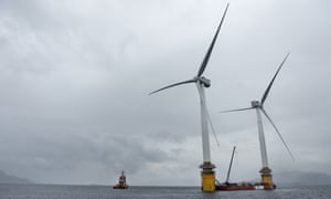 Two of the floating turbines are readied off the coast of Norway for the trip to Scotland.