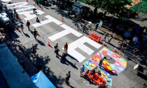Protesters in Seattle's Capitol Hill Autonomous Zone decorate their Black Lives Matter mural