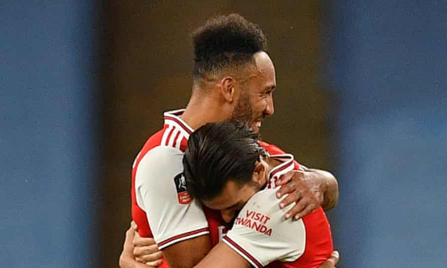 Arsenal's Pierre-Emerick Aubameyang (left) and Dani Ceballos celebrate after the final whistle. The manager will have to work hard to keep both at the club this summer.