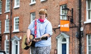 Kathleen Jones with her guitar outside the Hive, Shrewsbury