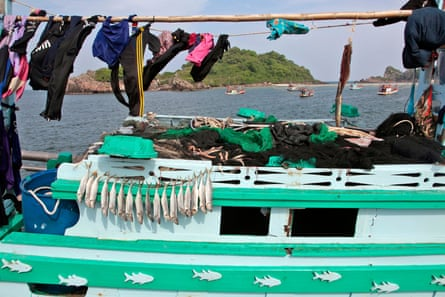 Fish are seen drying on a boat in the Thai fishing port of Bang Saphan