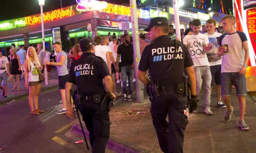Police officers patrol Punta Ballena street in Magaluf.
