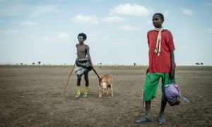 Men on a drought-ravaged field in Ethiopia
