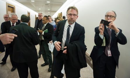 Quick exit: Backpage CEO Carl Ferrer leaves the Senate Homeland Security and Governmental Affairs subcommittee hearing after invoking his Fifth Amendment right against self-incrimination.