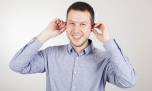 assistant technology editor Samuel Gibbs testing bluetooth earbuds