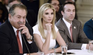 Ivanka Trump is flanked by executives in a meeting with her father.