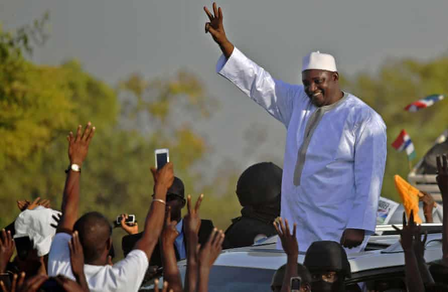 The Gambia's new president, Adama Barrow, waves to supporters on 26 January 2017