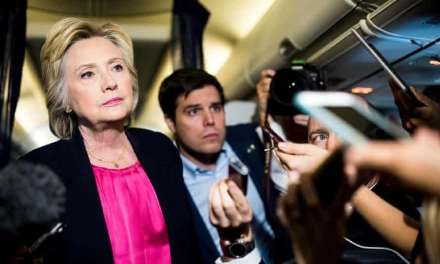 Cabin pressure … Hillary Clinton takes questions on board her campaign plane in 2016.