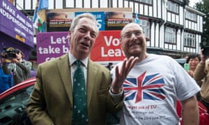 Ukip leader Nigel Farage stands with a Brexit supporter during his party's referendum Brexit battlebus tour in Kingston, London.