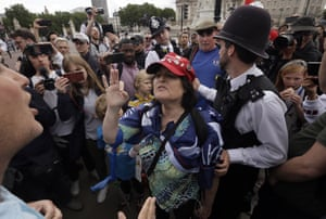 A fan of Donald Trump argues with anti-Trump protesters outside Buckingham Palace