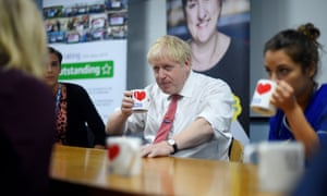 Boris Johnson speaking to mental health professionals during his visit to Watford general hospital in Watford.