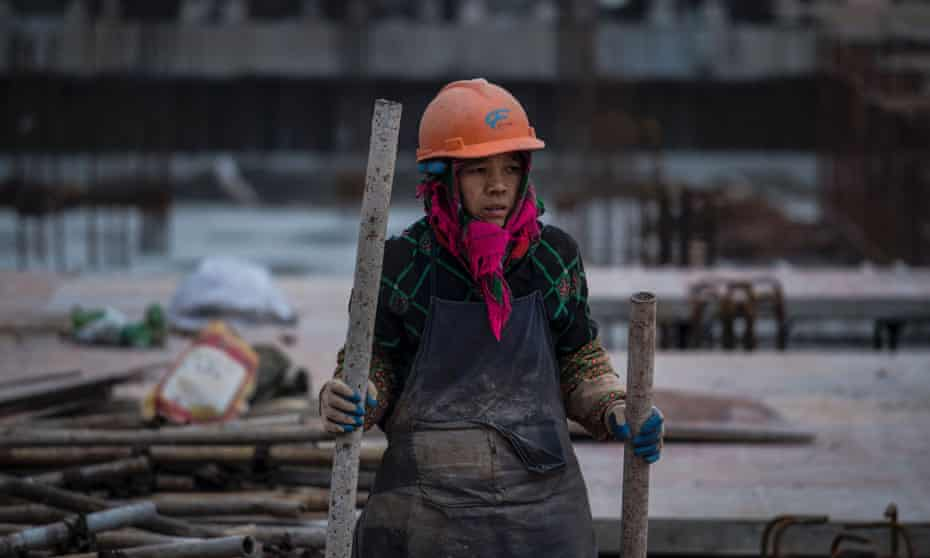 A woman working at a building site in Shanghai in November.