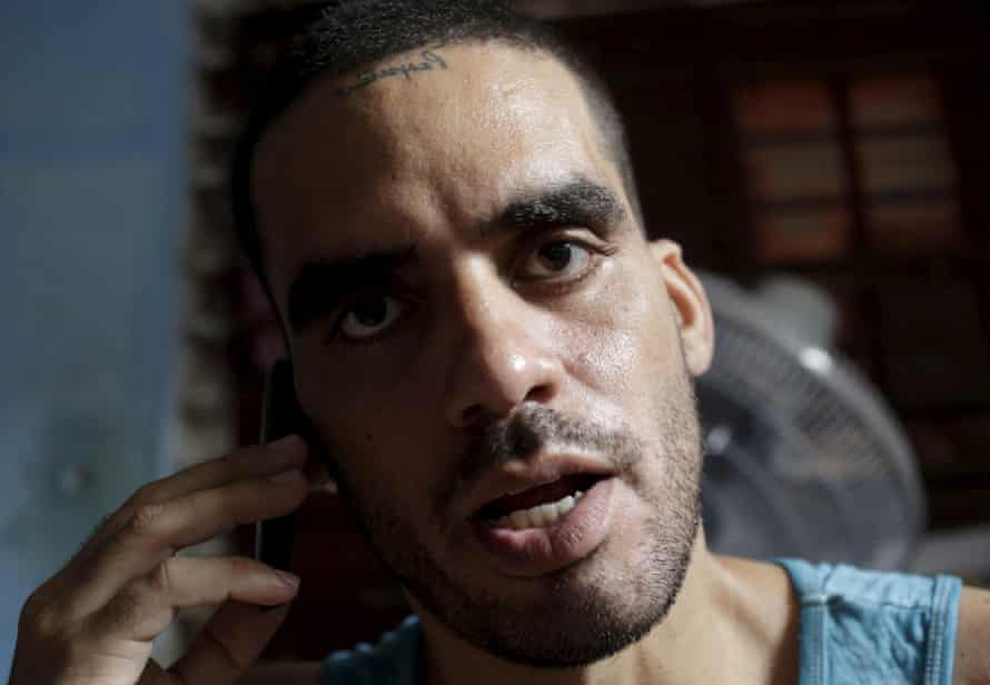 Cuban graffiti artist Danilo Maldonado speaks on his cellphone in his house in Havana, October 2015