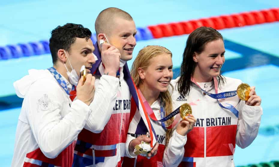 James Guy, Adam Peaty, Kathleen Dawson and Anna Hopkin with their gold medals.